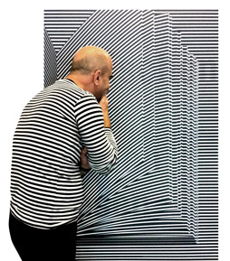 Volker Pook looking at a poster with stripes